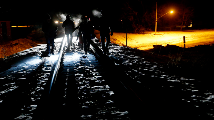 Asylum seekers from Somalia cross into Canada illegally from the United States by walking down a train track into the town of Emerson, Man., early Sunday morning, Feb. 26, 2017.