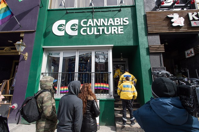 Store employees, media, and supporters are seen outside the Cannabis Culture store on Church Street during a police raid in Toronto on Thursday, March 9, 2017. Prominent marijuana activists Marc and Jodie Emery have been arrested in Toronto and police are raiding several pot dispensaries associated with the couple.