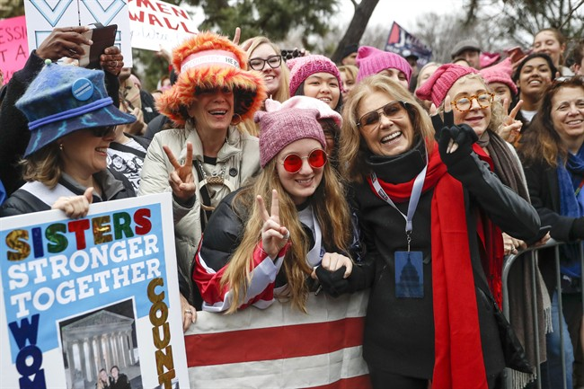 In this Jan. 21, 2017 file photo, Gloria Steinem, center right, greets protesters at the barricades before speaking at the Women's March on Washington during the first full day of Donald Trump's presidency, in Washington.