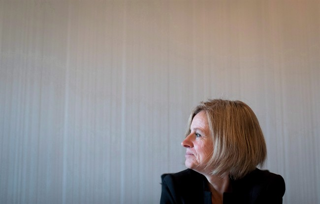 Alberta Premier Rachel Notley pauses to look out a window at Coal Harbour during an interview in Vancouver, B.C., on Tuesday December 6, 2016.