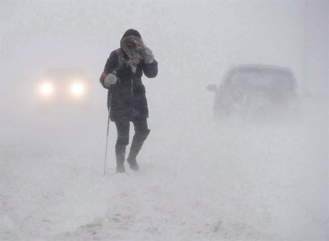 A pedestrian walks down Brunswick Street near Citadel Hill in Halifax as a major winter storm blasts the Maritimes on Monday, Feb. 13, 2017.
