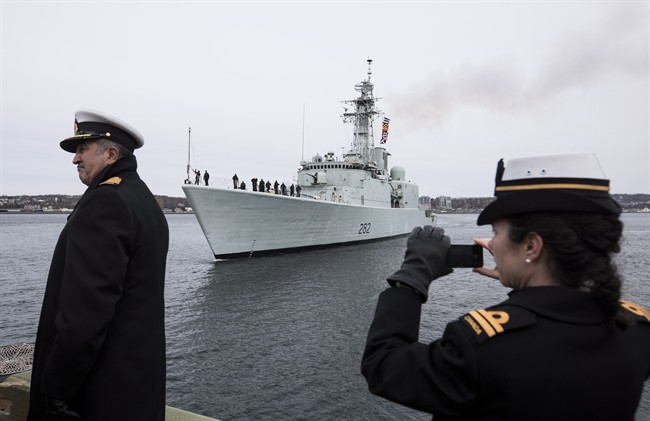 Family, veterans, and dignitaries watch as the HMCS Athabaskan makes its final sail in the Halifax Harbour during the ship's paying off ceremony in Halifax on Friday, March 10, 2017.