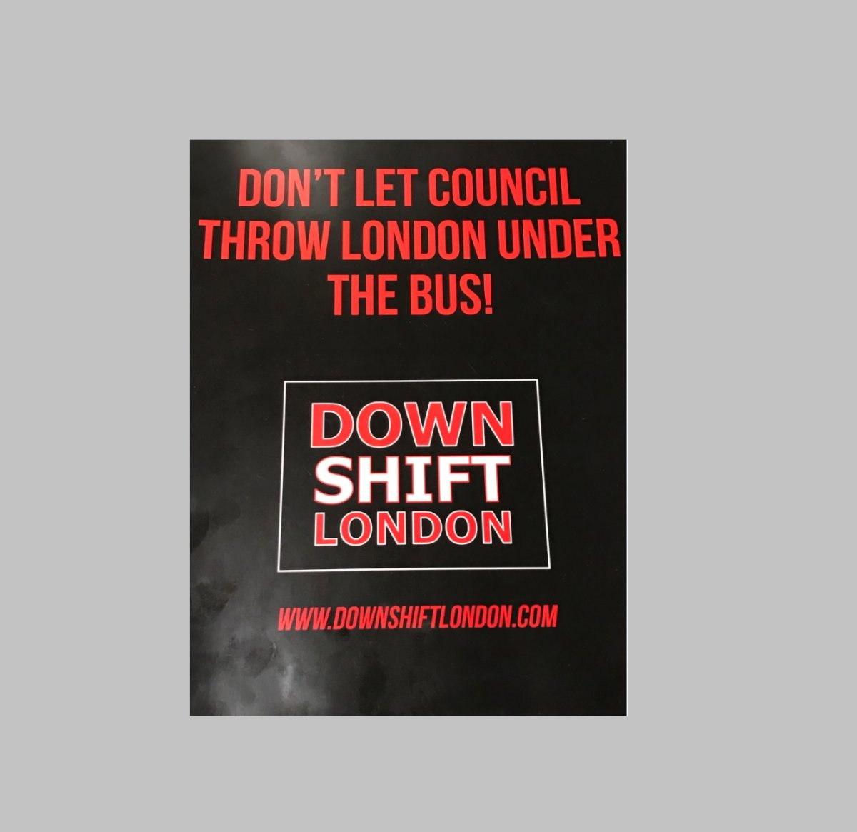 New lawn and window signs being distributed to residents and business owners by Down Shift London.