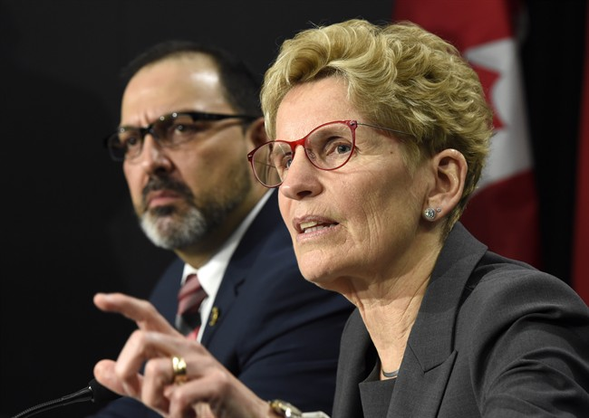 Ontario Premier Kathleen Wynne, right, speaks as Ontario Energy Minister Glenn Thibeault looks on during a press conference in Toronto on Thursday, March 2, 2017.
