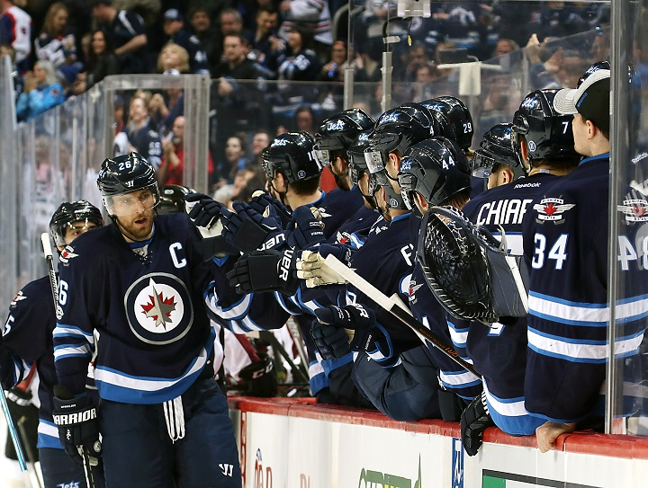 Blake Wheeler of the Winnipeg Jets celebrates his first period goal against the Colorado Avalanche with his teammates at MTS Centre on March 4, 2017.