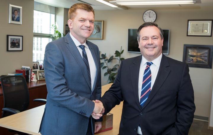 A photo of Wildrose Leader Brian Jean and Progressive Conservative Leader Jason Kenney.