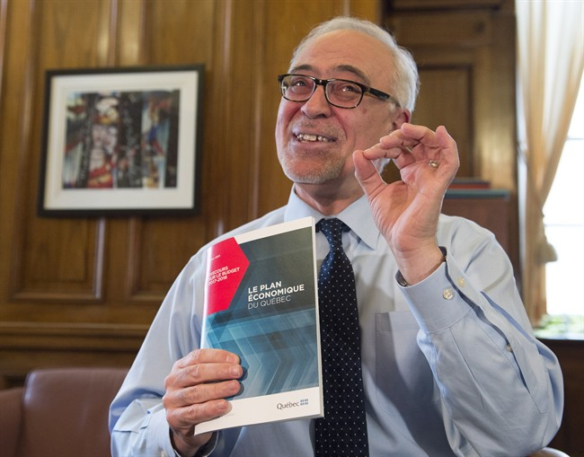 Quebec Finance Minister Carlos Leitao displays his budget speech, on the eve of a provincial budget speech, Monday, March 27, 2017 in Quebec City.