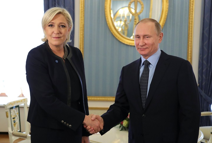 Russian President Vladimir Putin shakes hands with Marine Le Pen, French National Front (FN) political party leader and candidate for the French 2017 presidential election, during their meeting in Moscow, Russia March 24, 2017.