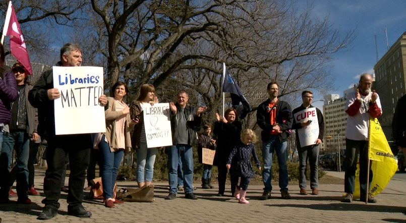 Many concerned about looming budget cuts to libraries came out to protest in downtown Regina on March 25, 2017.