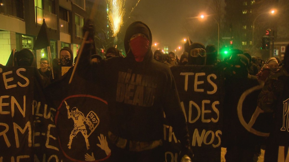 Protesters march in the annual against police brutality demonstration in Montreal, Wednesday, March 15, 2017.