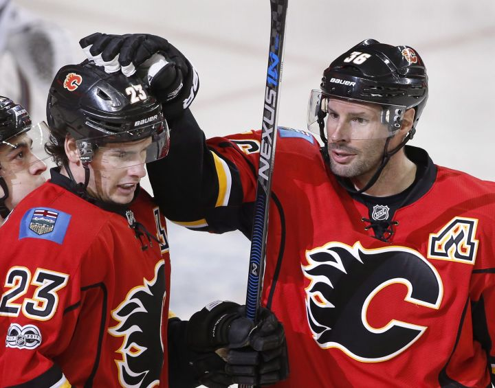 Calgary Flames' Sean Monahan, left, celebrates his goal with Troy Brouwer against the Colorado Avalanche during first period NHL action in Calgary, Alta., Monday, March 27, 2017.
