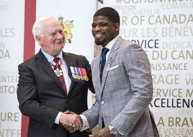 Nashville Predators' P.K. Subban shakes hands with Governor General David Johnston after receiving the Meritorious Service Decoration, Wednesday, March 1, 2017 in Montreal.