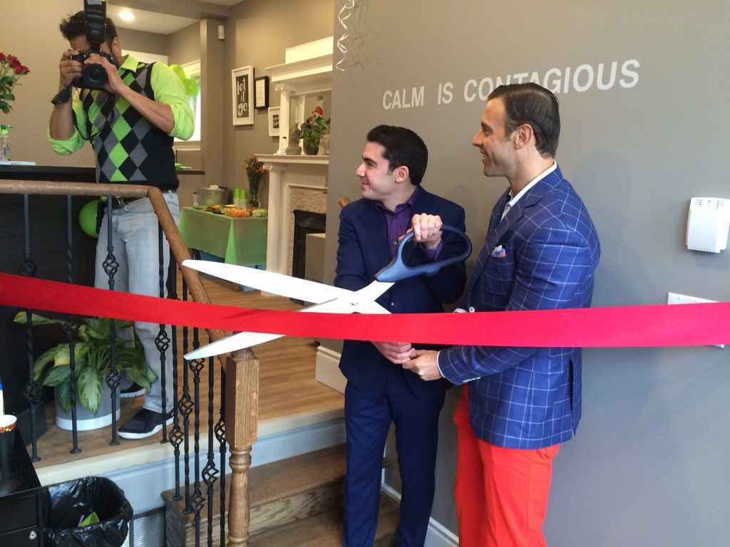 Dr. Mike Hart and Adam Saperia cut the ribbon for the grand opening of Ready to Go Clinic on Richmond Row on March 31, 2017.