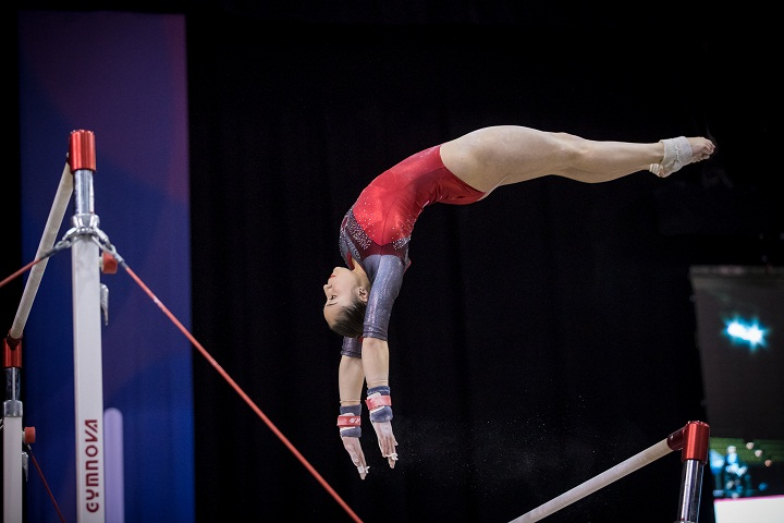 Canadian Rose Woo performs on the uneven bars at the Gymnix International competition in Montreal on Friday, March 10, 2017.