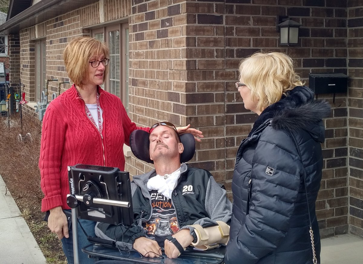 London West NDP MPP Peggy Sattler (far right) meets with Shawn Eyre and his sister Tanya Dallaire to call on the provincial Liberals to address a shortage in assisted housing.