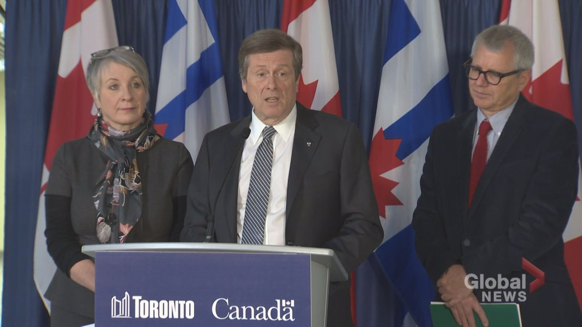 Mayor John Tory (centre) speaks to the media about a youth job funding announcement at city hall on March 14, 2017.