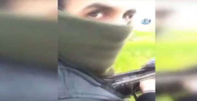 This screen grab appears to show Wassim B practicing firing a weapon in the Syrian countryside.