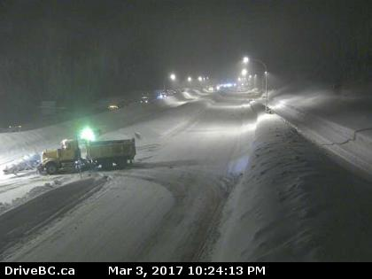 A snowplow truck makes a u-turn on the Coquihalla Friday night, where northbound traffic was shutdown at 10:30 p.m.