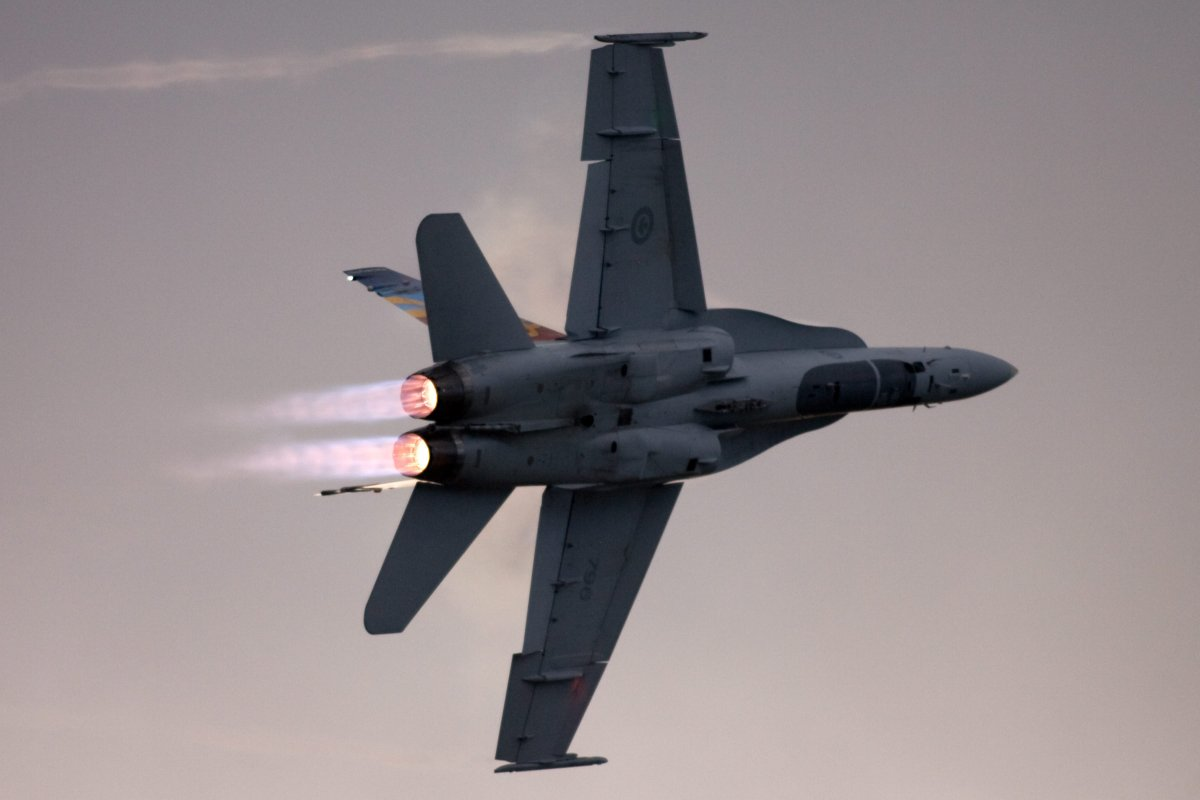 A Canadian Forces CF-18 makes a highspeed afterburner turn at the Great Lakes International Air Show.