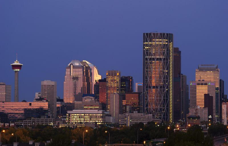 The downtown skyline of Calgary, Alberta at sunrise.