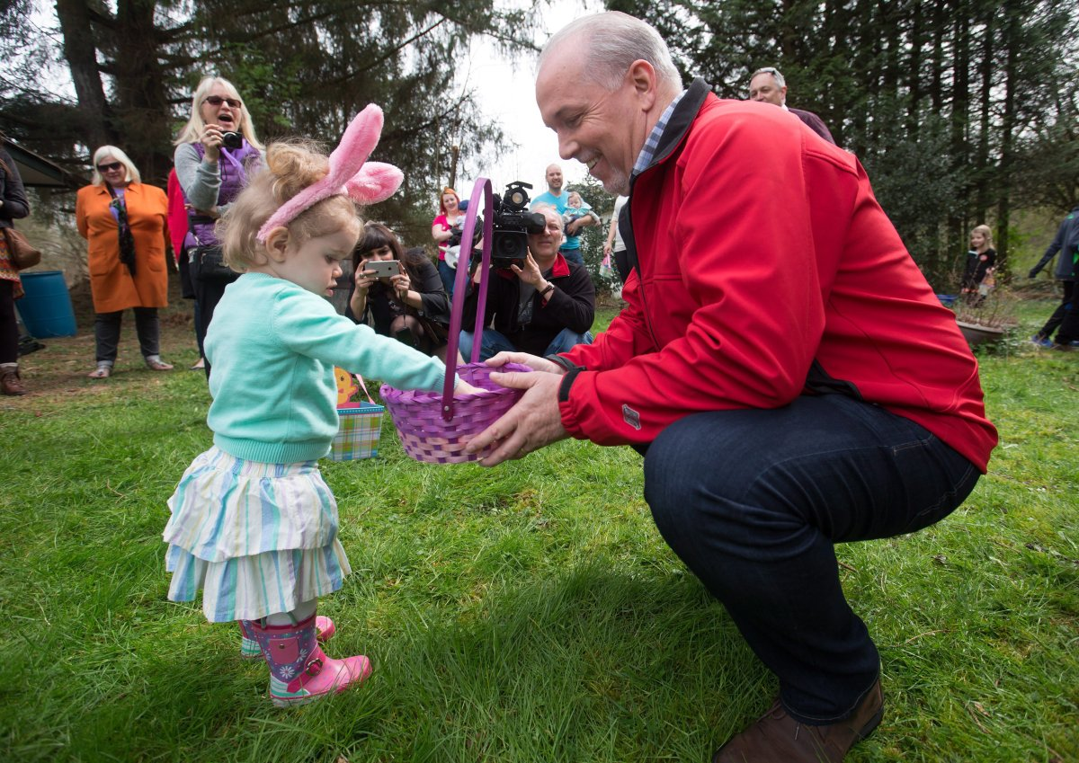 NDP Leader John Horgan hands out chocolates during an Easter egg hunt at a supporter's home in Maple Ridge, B.C., on Sunday April 16, 2017. A provincial election will be held on May 9. THE CANADIAN PRESS/Darryl Dyck.