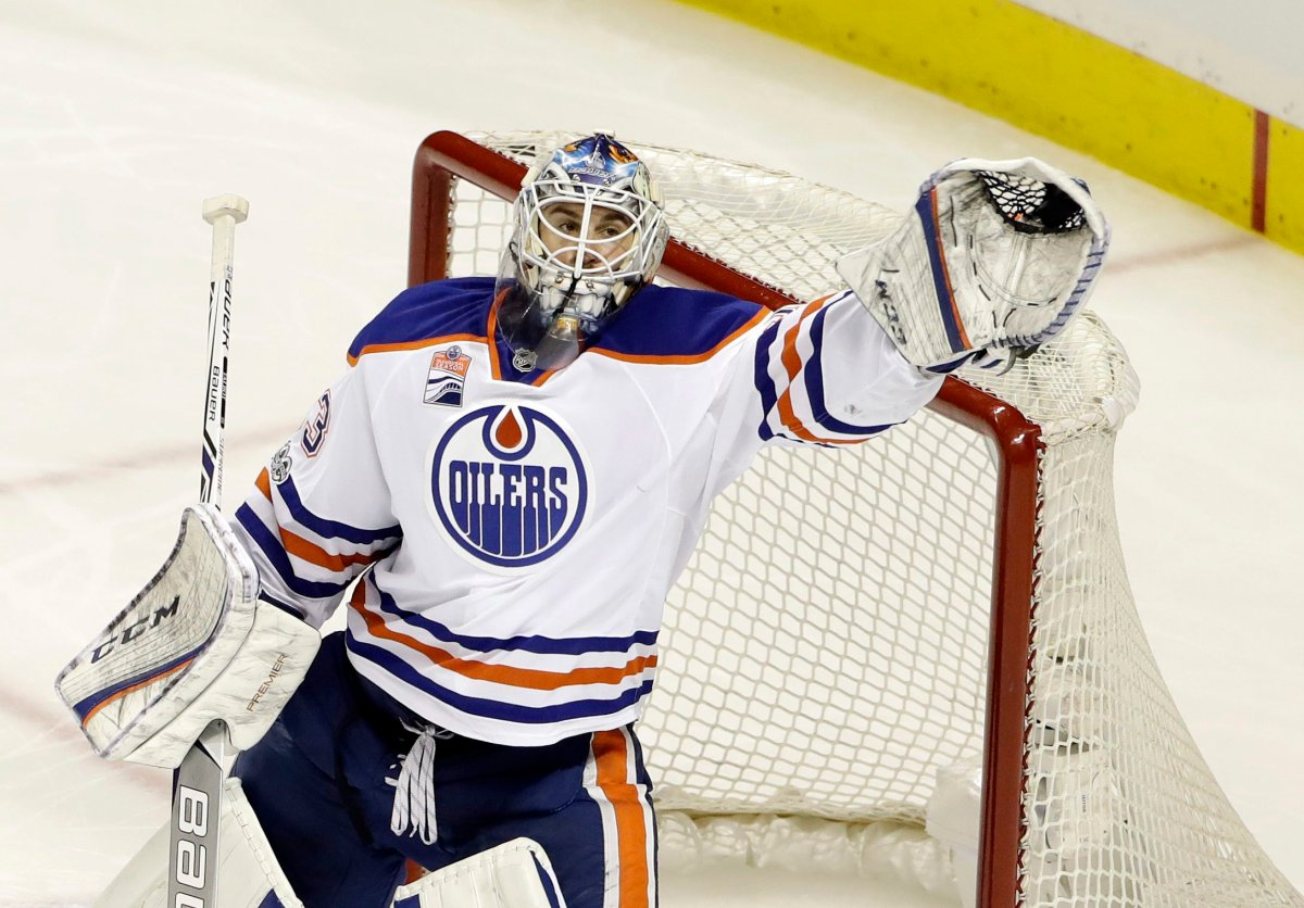 Edmonton Oilers goalie Cam Talbot stops a shot against the San Jose Sharks during the third period in Game 3 of a first-round NHL hockey playoff series Sunday, April 16, 2017, in San Jose, Calif. (AP Photo/Marcio Jose Sanchez).