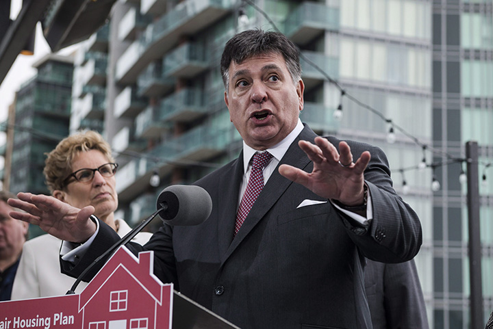 Ontario Finance Minister Charles Sousa speaks about Ontario's Fair Housing Plan during a press conference in Toronto on Thursday, April 20, 2017.