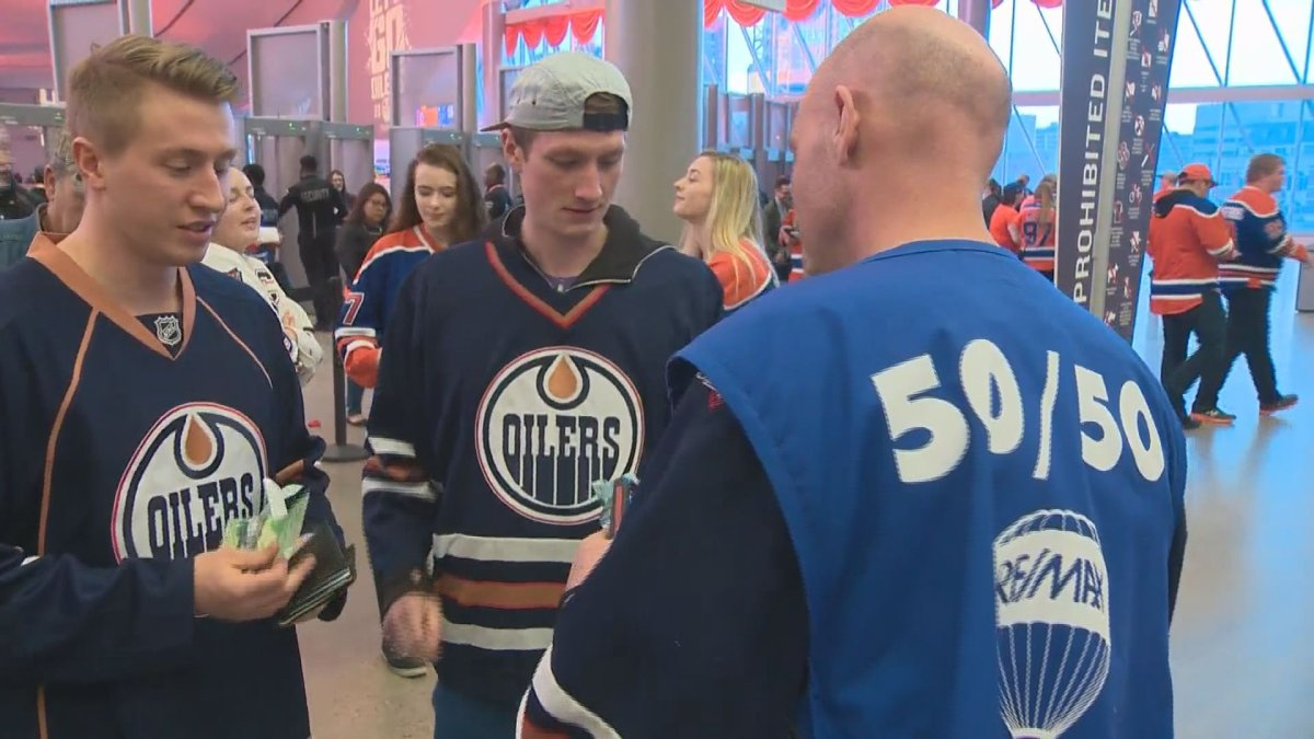 The Edmonton Oilers Community Foundation sells 50/50 tickets at Friday's Oilers watch party at Rogers Place, April 28, 2017.