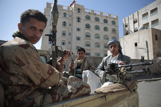Shiite fighters, known as Houthis, pose for a photo.