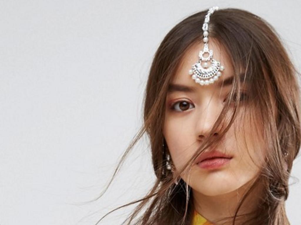 "U.K. retailer Asos receives criticism for calling a South Asian tikka a ""chandelier hair clip.""."