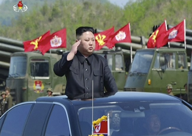 """This image made from video of a still image broadcast in a news bulletin by North Korea's KRT on April 26, 2017, shows leader Kim Jong Un at what was said to be a """"Combined Fire Demonstration"""" held to celebrate the 85th anniversary of the North Korean army."""