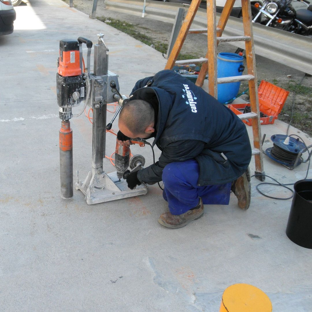 Crews installing parking occupancy sensors in downtown Burlington.