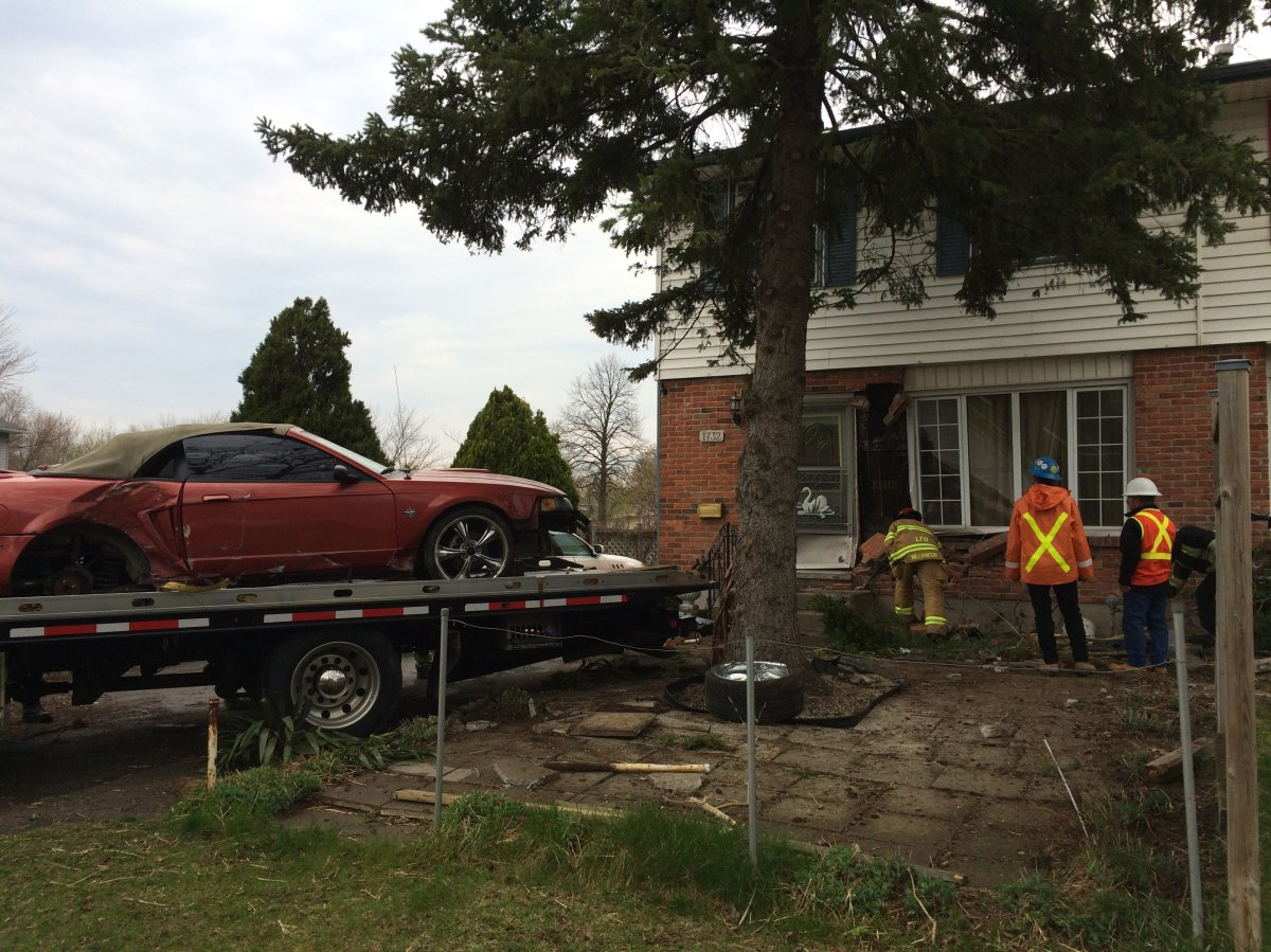 Police tow away vehicle that struck a home on Culver Drive on Wednesday, April 19, 2017.