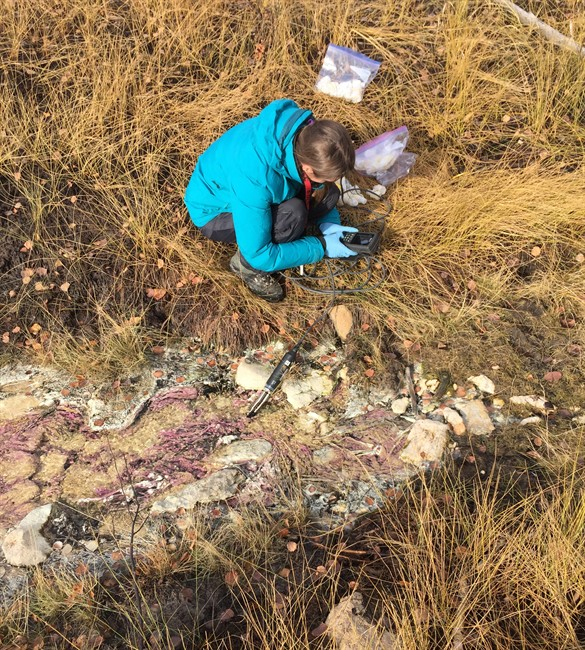 University of Calgary student Jessica Ellis collects a sample of fossil groundwater in northeastern Alberta in an Oct., 2016 handout photo.