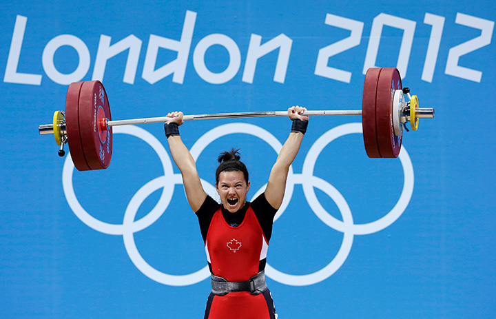 Canada's Christine Girard competes during the women's 63-kg weightlifting competition at the 2012 Summer Olympics, Tuesday, July 31, 2012, in London.