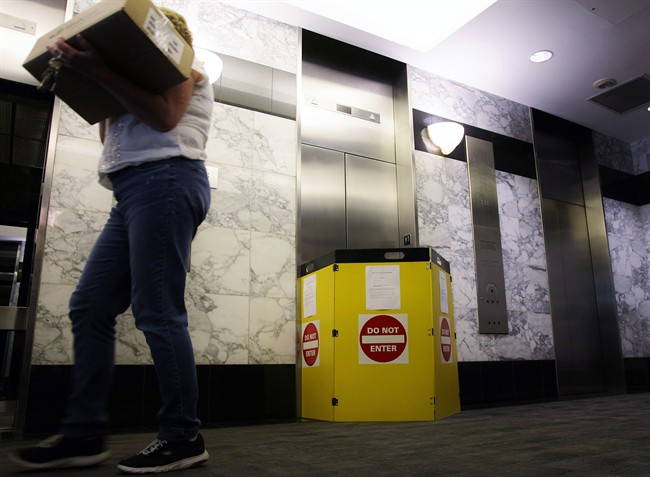 An out-of-service elevator is seen at downtown Toronto building on Thursday, April 27, 2017. Ontario is looking for bidders to do research into elevator reliability and propose solutions.