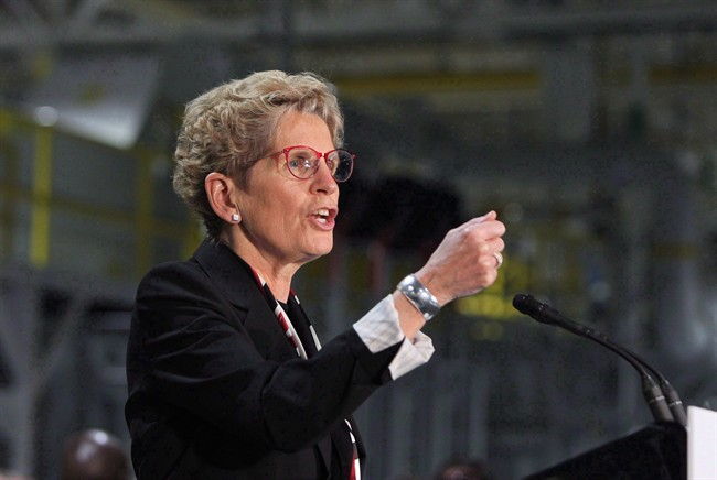 Ontario Premier Kathleen Wynne did not say Monday what the province's new minimum wage would be.