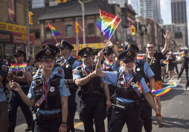 Hamilton, Ont. police officers march along the parade route during the annual Pride Parade in Toronto, Sunday, July 3, 2016.