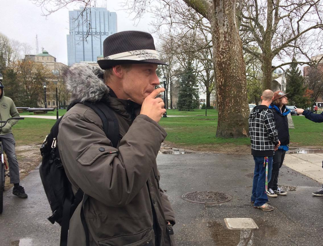 A man smokes a joint during a 4/20 rally at Victoria Park, on April 20, 2017.