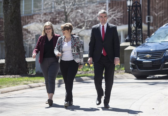 Nova Scotia Premier Stephen McNeil, right, walks toward Government House with his daughter Colleen, left, and wife Andrea to ask the Lieutenant Governor to dissolve the House in order to call a provincial election in Halifax on Sunday, April 30, 2017.