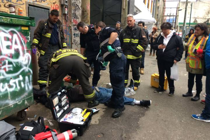 First responders tend to an overdose victim in Vancouver's Downtown East Side.
