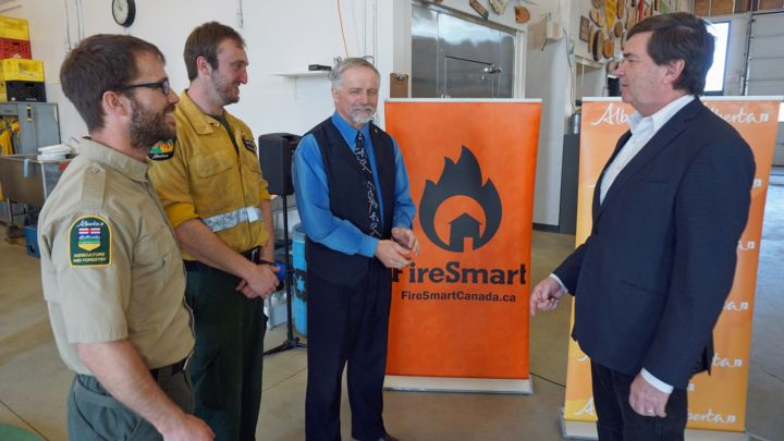 The Alberta government says it will spend $45 million over the next three years to help protect communities from wildfires.