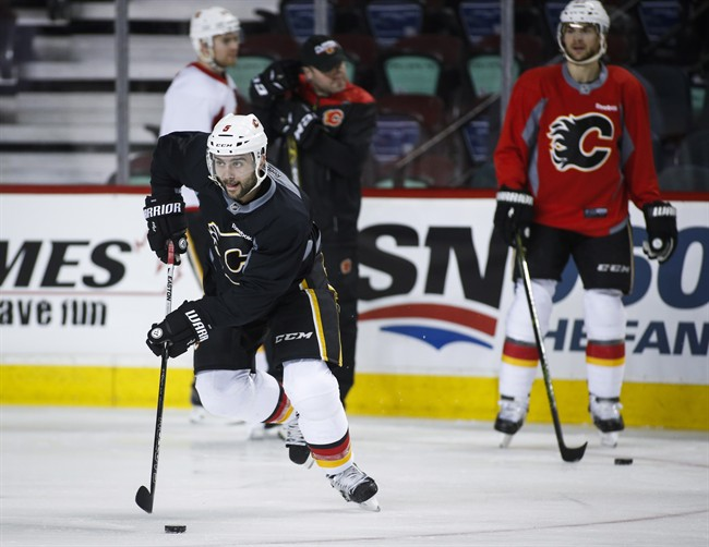 Calgary Flames' Mark Giordano skates during a team practice in Calgary, Monday, April 10, 2017.