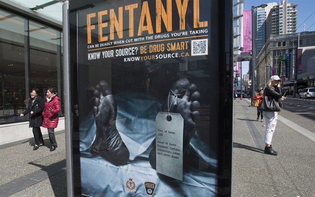 An anti-fentanyl advertisment is seen on a sidewalk in downtown Vancouver, Tuesday, April, 11, 2017.
