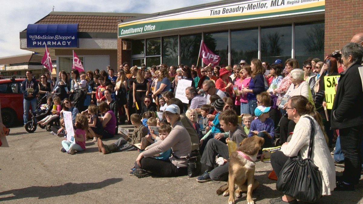 Over one hundred people gathered outside Social Service Minister Tina Beaudry-Mellor's constituency office.