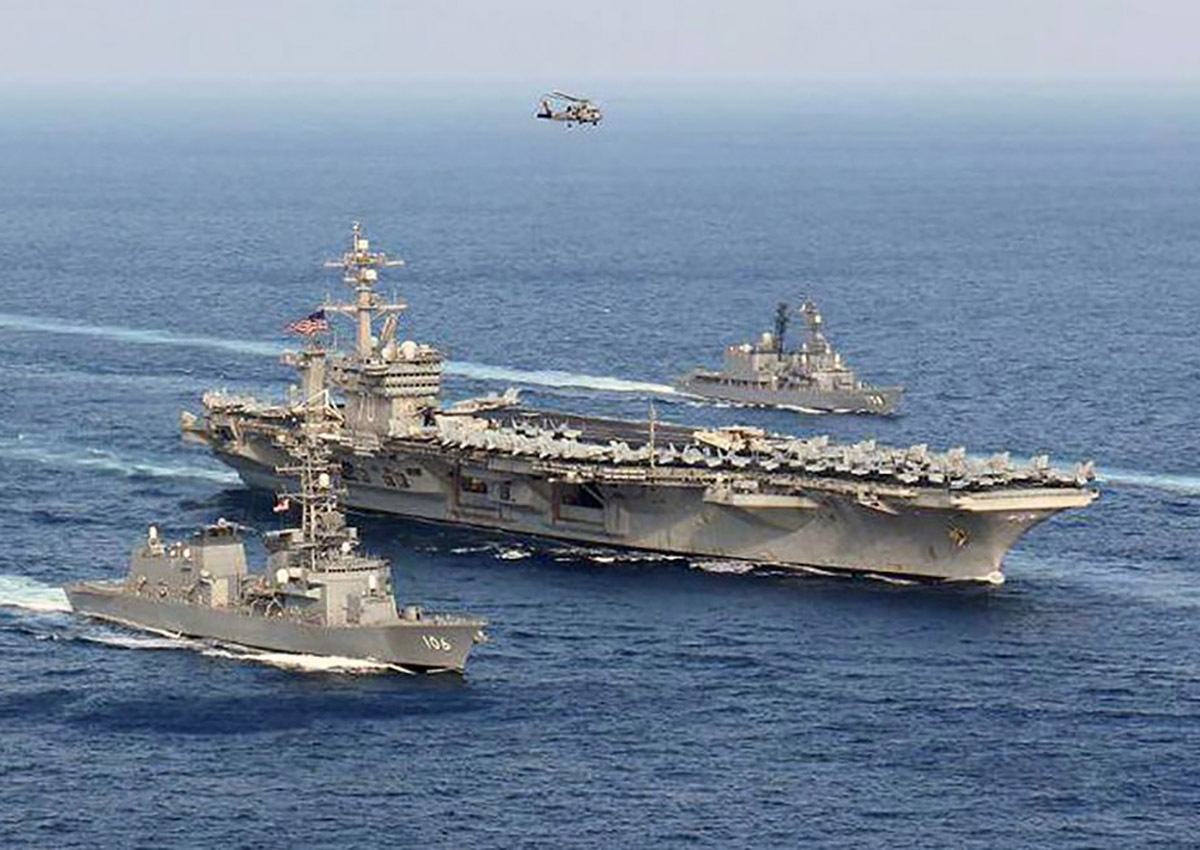 USS Carl Vinson (CVN 70) and Japan Maritime Self-Defense Force (JMSDF) ships steam in formation at the conclusion of a bilateral exercise to increase proficiency in basic maritime skills and improve response capabilities, Mar. 29, 2017.