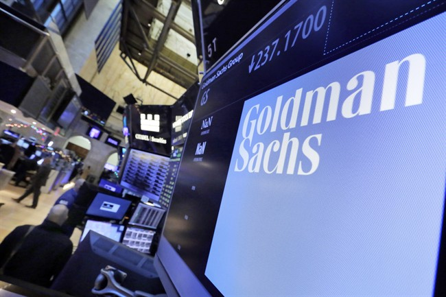 The Goldman Sachs logo appears above a trading post on the floor of the New York Stock Exchange, Dec. 13, 2016.
