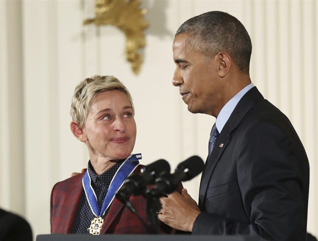 In this Nov. 22, 2016 file photo, actress, comedian, and talk show host Ellen DeGeneres, glances at President Barack Obama as she is presented the Presidential Medal of Freedom during a ceremony in the East Room of the White House in Washington.
