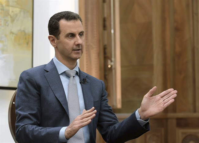 Syrian President Bashar Assad speaks during an interview with Yahoo News in Damascus, Syria.