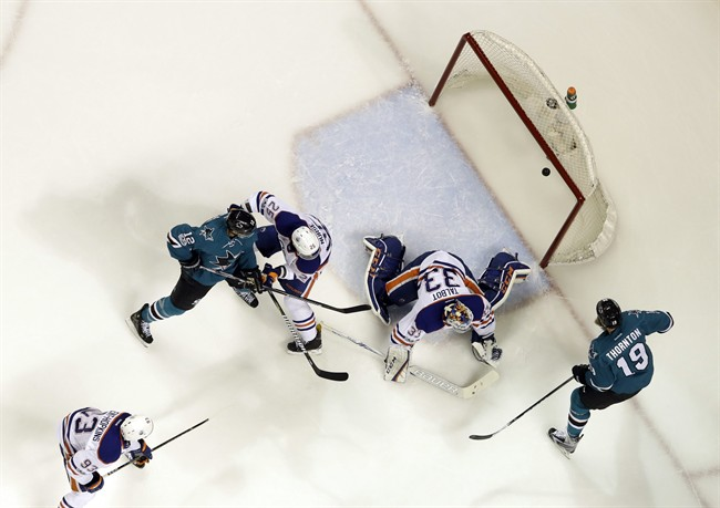 Edmonton Oilers goalie Cam Talbot, center, is beaten for a goal on a shot from San Jose Sharks' Logan Couture, not seen, as Joe Thornton (19), Oilers' Darnell Nurse (25) Sharks' Patrick Marleau (12) and Oilers' Ryan Nugent-Hopkins (93) watch during the first period in Game 4 of a first-round NHL hockey playoff series Tuesday, April 18, 2017, in San Jose, Calif.
